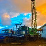 Well drilling with dramatic sky